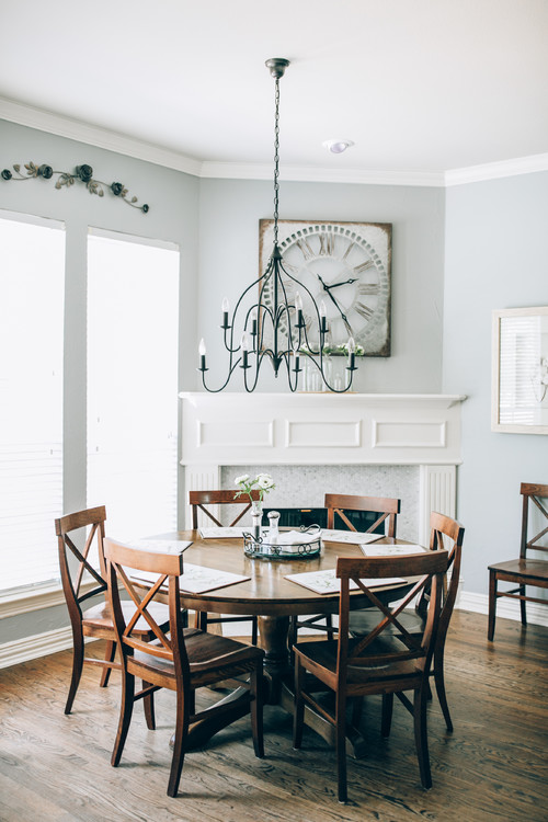 Modern Farmhouse Dining Room with Round Wooden Table and Wooden X-Back Dining Chairs