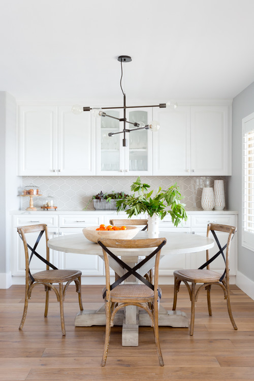 Modern Farmhouse Dining Room with White Round Table and X-Back Dining Chairs