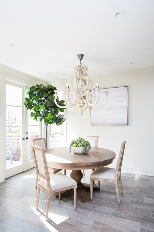 Modern Farmhouse Dining Room with Whitewashed Wooden Table and Dining Chairs