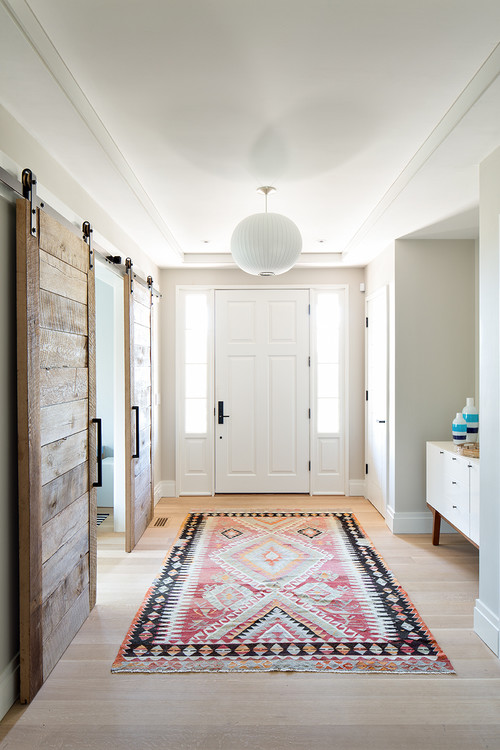 Modern Farmhouse Entryway with White Four Panel Door Flanked by Side Lites