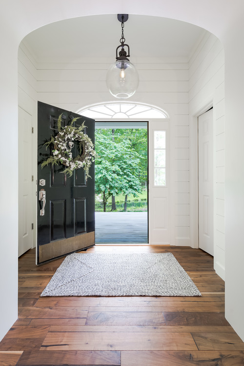 Modern Farmhouse Entryway Black Door Flanked by Side Lites
