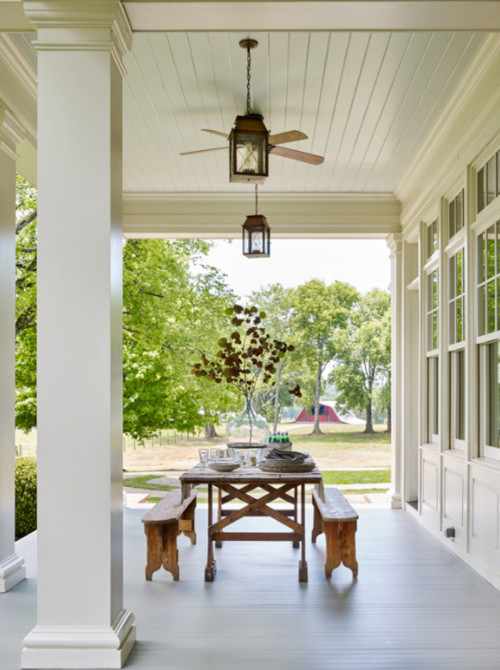 Modern Farmhouse Porch with Picnic Table