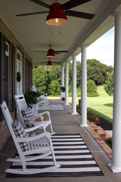 Modern Farmhouse Porch with White Rocking Chairs
