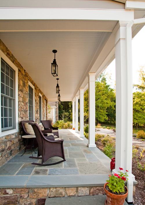 Modern Farmhouse Porch with Wicker Patio Furniture