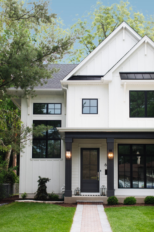 Modern White Farmhouse Exterior with Black Front Door and Window Trim