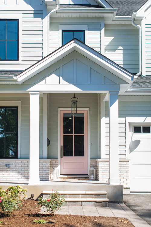 Modern White Farmhouse Exterior with Closeup of Light Pink Front Door