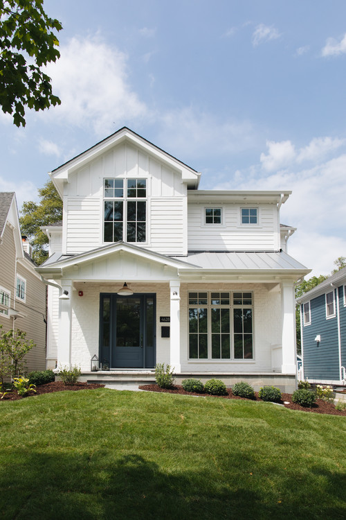 Modern White Farmhouse Exterior with Dark Blue Front Door