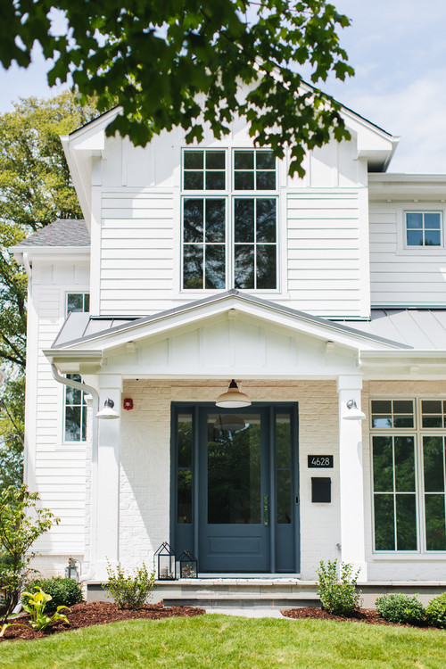Modern White Farmhouse Exterior with Dark Blue and Glass Front Door