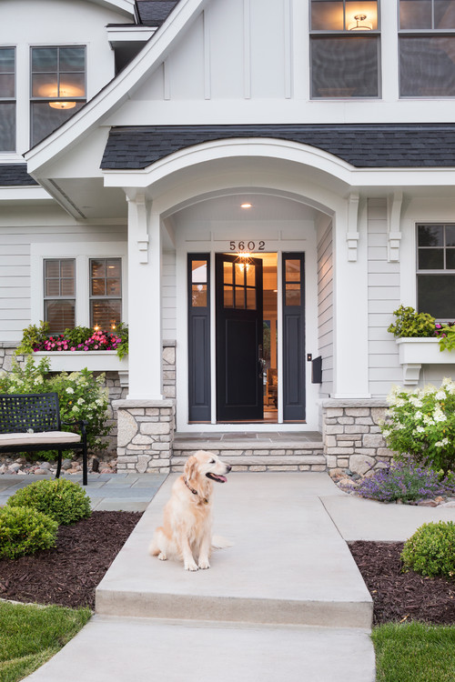 Modern White Farmhouse Exterior with Dark Gray Front Door and Sidelites