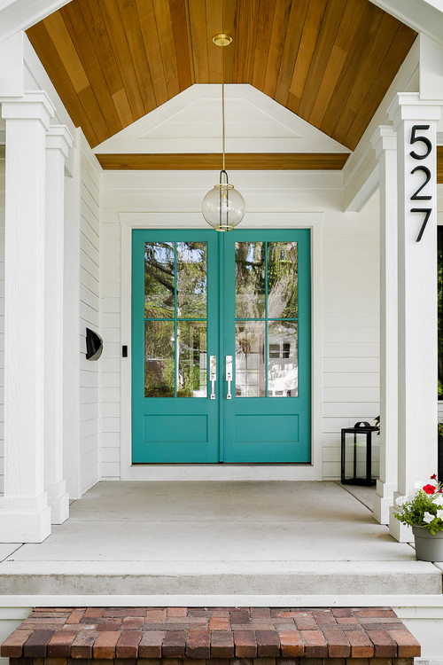 Modern White Farmhouse Exterior with Front Door Painted in Benjamin Moore Blue Spa