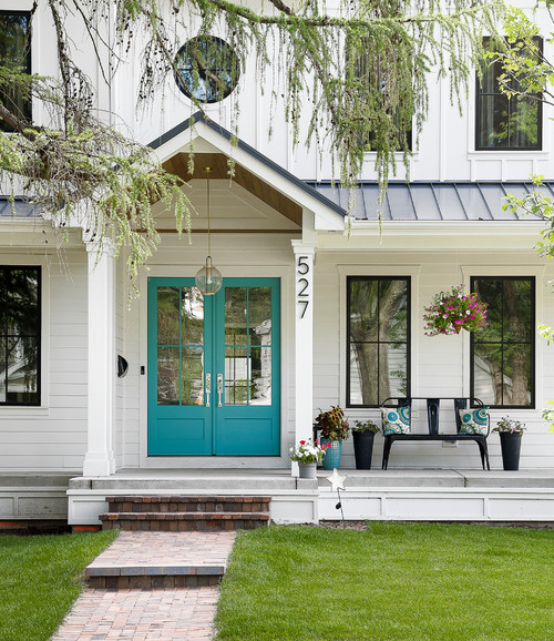 Modern White Farmhouse Exterior with Front Door Painted in Benjamin Moore