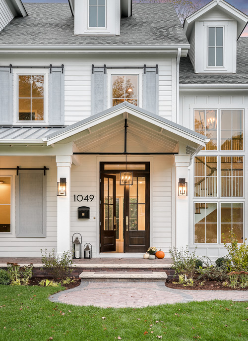 Modern White Farmhouse Exterior with Gray Barn Door Shutters