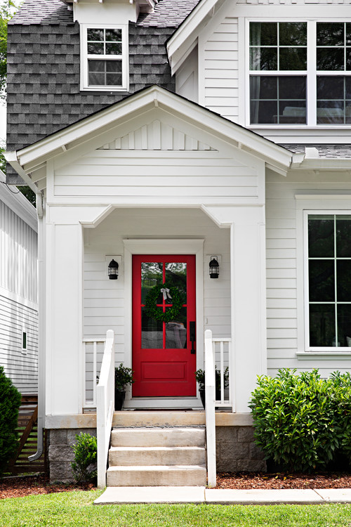 Modern White Farmhouse Exterior with Red and Glass Front Door