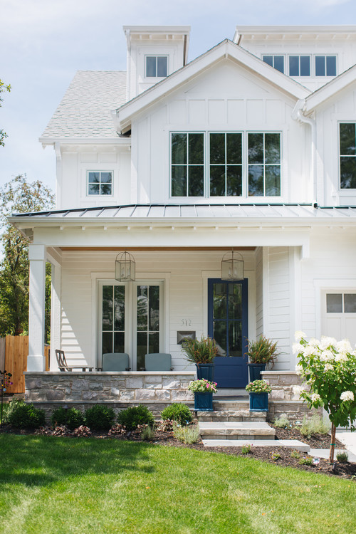 Modern White Farmhouse Exterior with Royal Blue and Glass Front Door