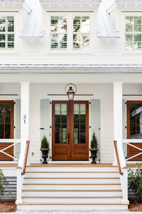 Modern White Farmhouse Exterior with Wooden French Doors