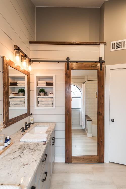 Neutral Modern Farmhouse Bathroom with Sliding Barn Door Mirror