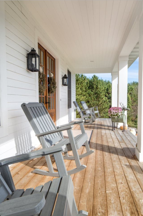 Classic Farmhouse Style Porch with Gray Rocking Chairs