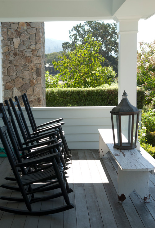Farmhouse Style Porch with Black Rocking Chairs