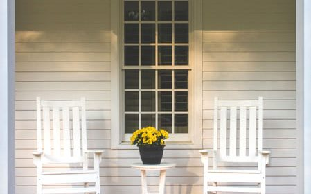 Farmhouse Style Porch with White Rocking Chairs