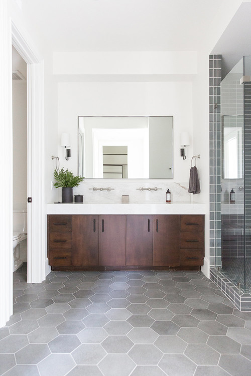Modern Farmhouse Mountain Home Bathroom with Wooden Vanity and Gray Hexagon Floor Tiles