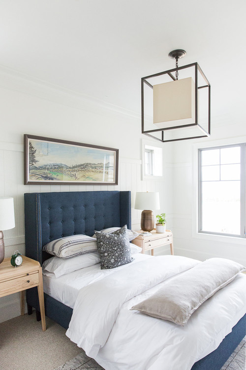 Modern Farmhouse Mountain Home Bedroom with Blue Tufted Headboard and Blue Fabric Bed Frame