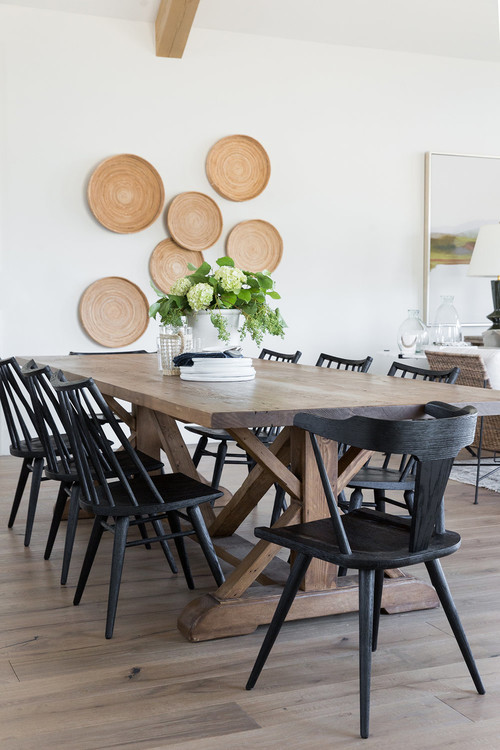 Modern Farmhouse Mountain Home Dining Room with Farmhouse Table and Black Wooden Chairs