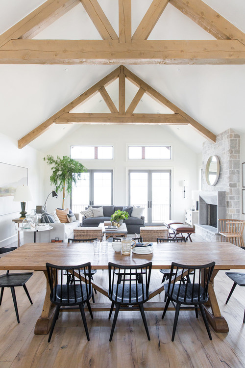 Modern Farmhouse Mountain Home Dining Room with Farmhouse Table and Wooden Ceiling Beams