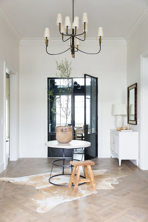 Modern Farmhouse Mountain Home Entryway with Wood Parquet Style Floor and Cowhide Rug