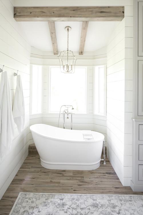 Modern Farmhouse Bathroom with Shiplap Walls Surrounding a Bay Window