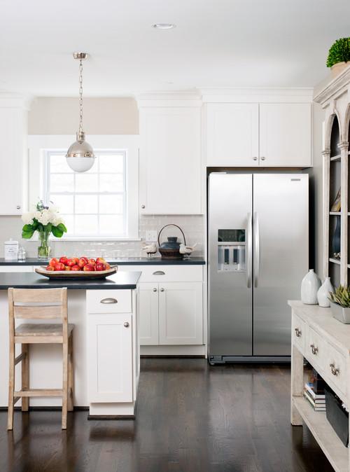 Modern Farmhouse Black and White Kitchen with Beige Tile Backsplash