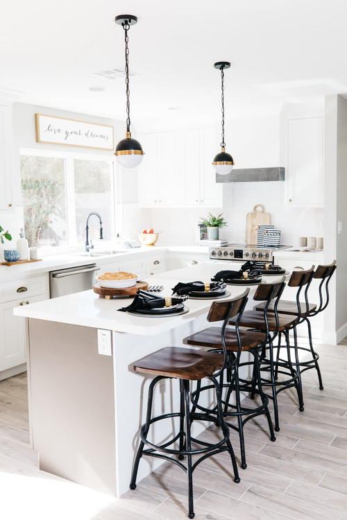 Modern Farmhouse Black and White Kitchen with Black and Wood Barstools