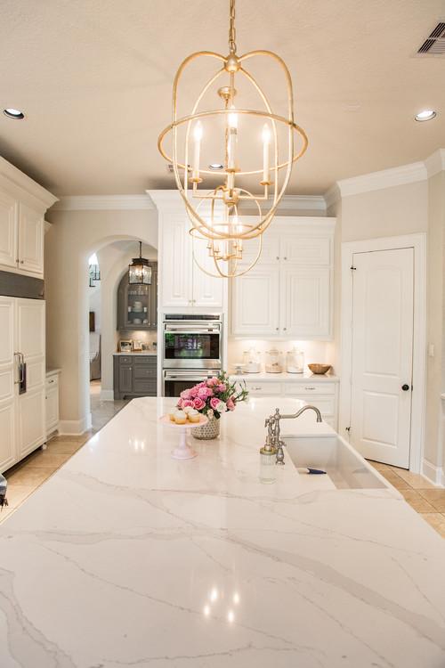 Modern Farmhouse Kitchen with Brass Orb Pendant Lights Over Kitchen Island