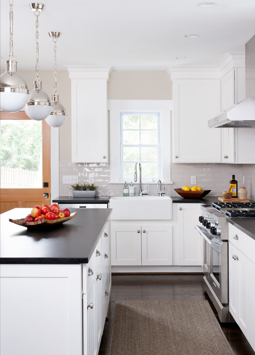 Modern Farmhouse Kitchen with White Cabinets and Black Countertops