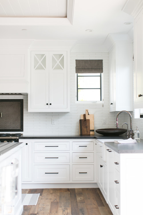 Modern Farmhouse White Kitchen with Black Countertops and Black Cabinet Pulls