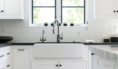 Modern Farmhouse White Kitchen with Black Countertops and Black Window Trim