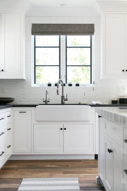 Modern Farmhouse White Kitchen with Black Countertops and Black Window Trim