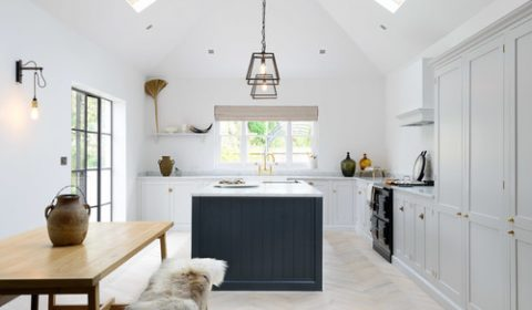 Modern Farmhouse White Kitchen with Black Kitchen Island and Black Trimmed Sky Lights