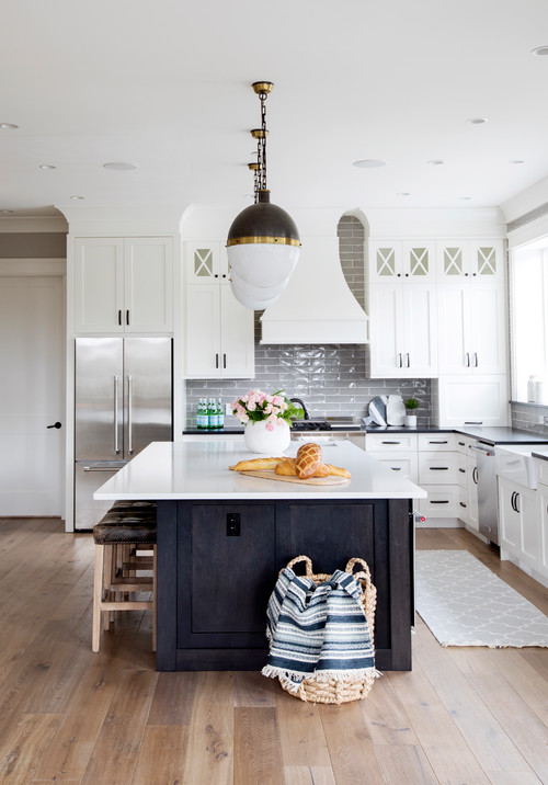 Modern Farmhouse White Kitchen with Black Kitchen Island and Black and White Globe Pendant Lights