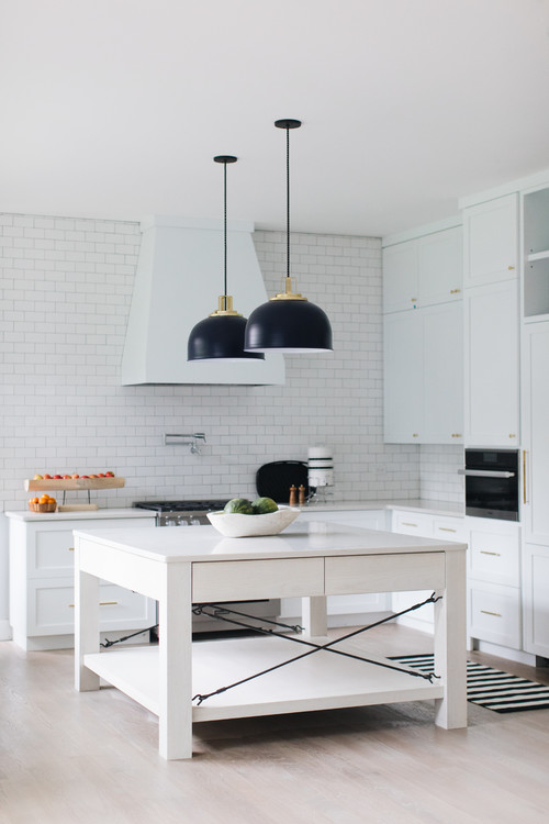 Modern Farmhouse White Kitchen with Black Pendant Lights and White Subway Tiled Wall