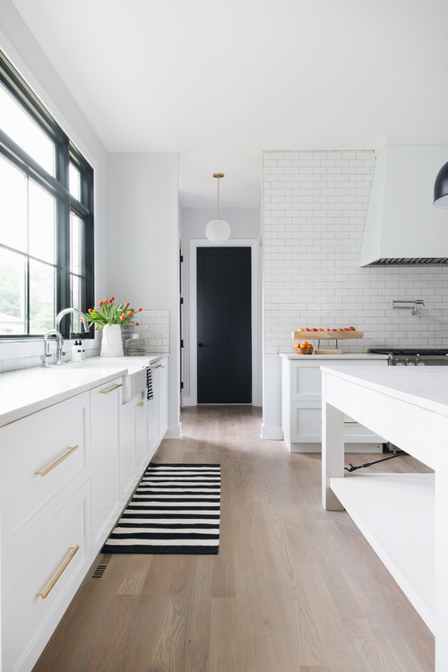 Modern Farmhouse White Kitchen with Black and White Striped Rug