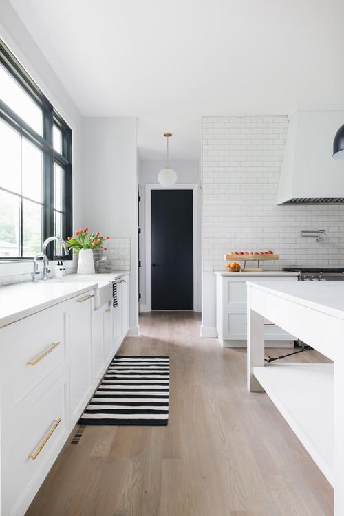 Modern Farmhouse White Kitchen with Black and White Striped Rug