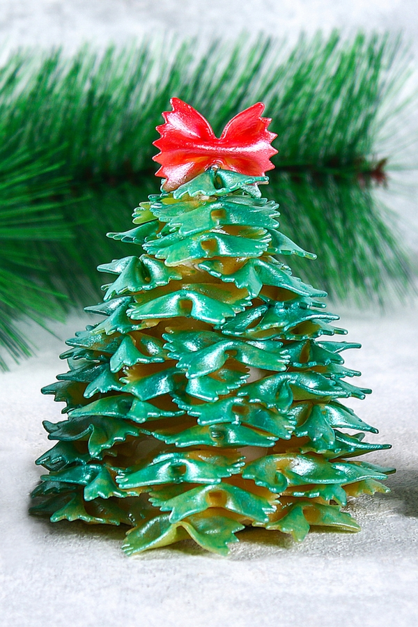 If you're looking for Rustic Christmas Decorations for the kiddos to make, look no further. This bow tie pasta Christmas tree is so fun to make!