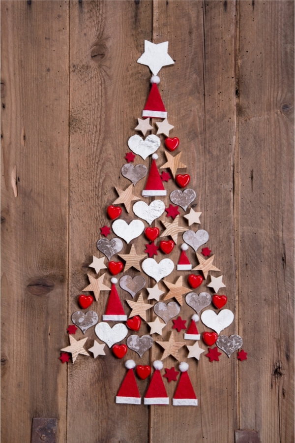 Looking for fun Rustic Christmas Decorations to make? All you need are some shapes, glue, and wood to make this adorable Christmas tree.