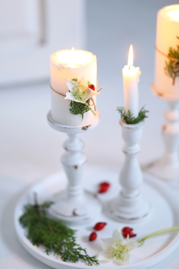 Candlesticks are a staple for farmhouse decor, so converting them into Christmas candlesticks is pretty easy. For the best farmhouse Christmas decor, look here.