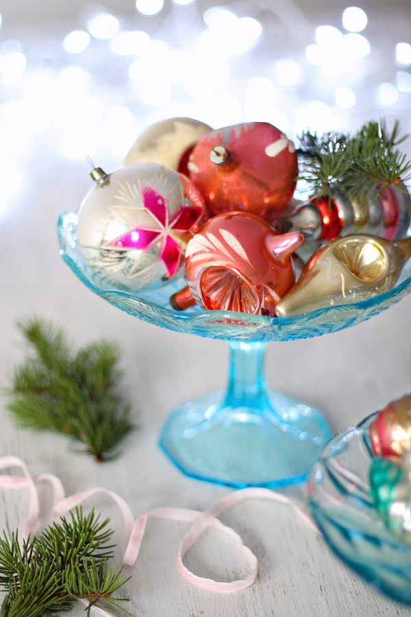 A glass candy bowl with ornaments is so cute and you can easily make it look rustic. For fun farmhouse Christmas decor ideas, look here.