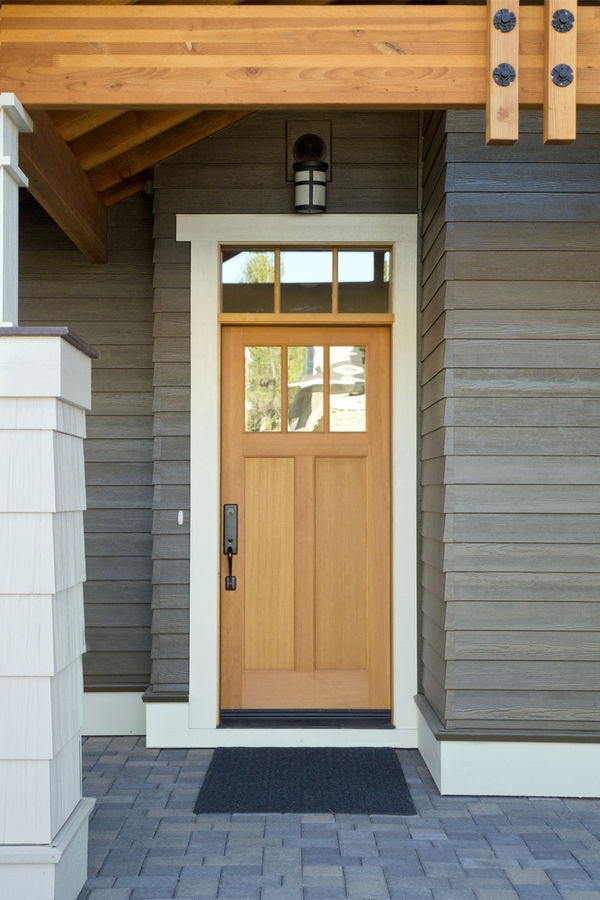 Do you love the look of modern farmhouses? Here are the best modern farmhouse exterior door colors to help you transform your home. A wood door will always look good.