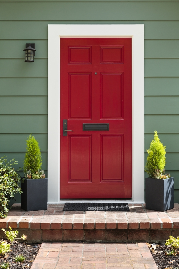 """Do you love the look of modern farmhouses? Here are the best modern farmhouse exterior door colors to help you transform your home. What says """"farmhouse"""" more than a red door?"""