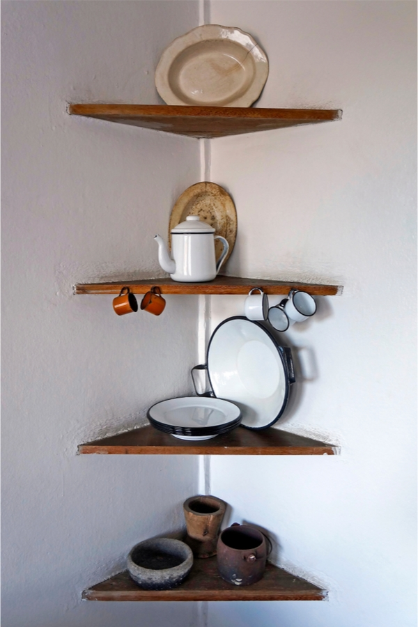 Today we're talking primitive kitchen farmhouse style. It's a fabulous combination of two complimentary design styles that we love here at Pickled Barrel. Rustic corner shelves are a great place to showcase your farmhouse decor.