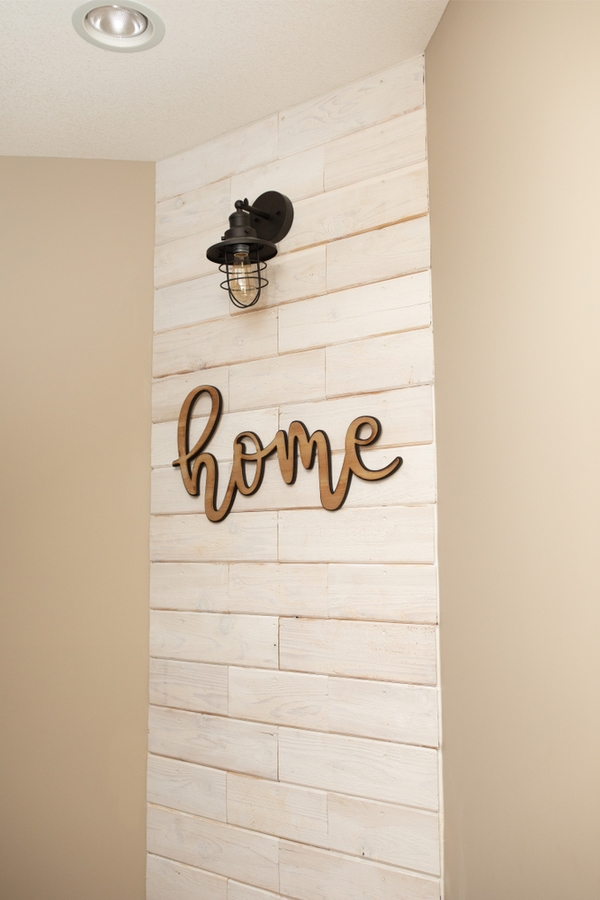 I'm going to show you the best decor ideas for a handmade reclaimed wood look, plus how to get that look with fresh wood. This cute wood shiplap wall would look great in any room.