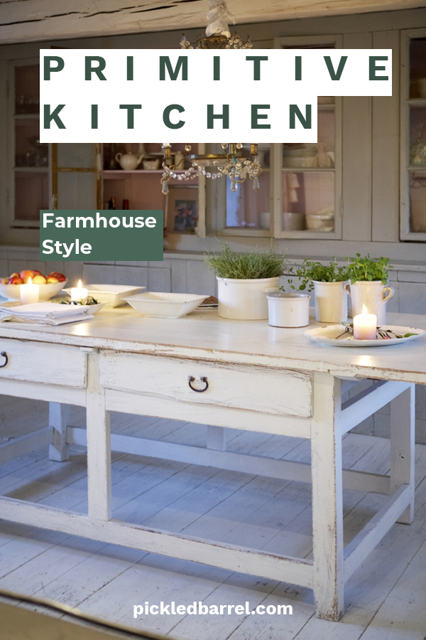 Farmhouse kitchens are cozy and make you feel so welcome. Today's post is all about a primitive farmhouse kitchen. Learn how to create this look with tips about cabinets, decor, lighting and more. For more info, keep on reading. You will love these primitive farmhouse ideas. #primitvefarmhousekitchen #farmhousekitchenideas #primitivefarmhousekitchenelements